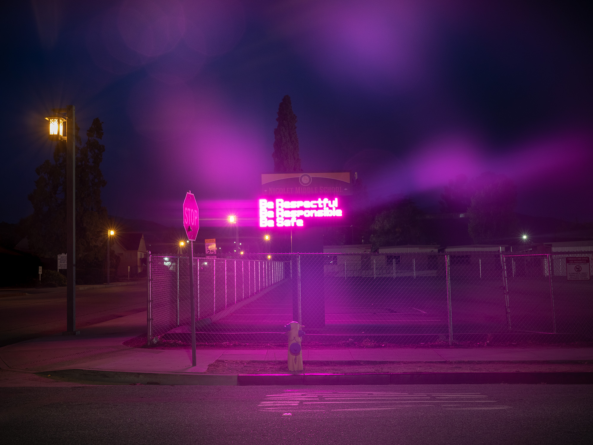 LED sign at night outside of high school.