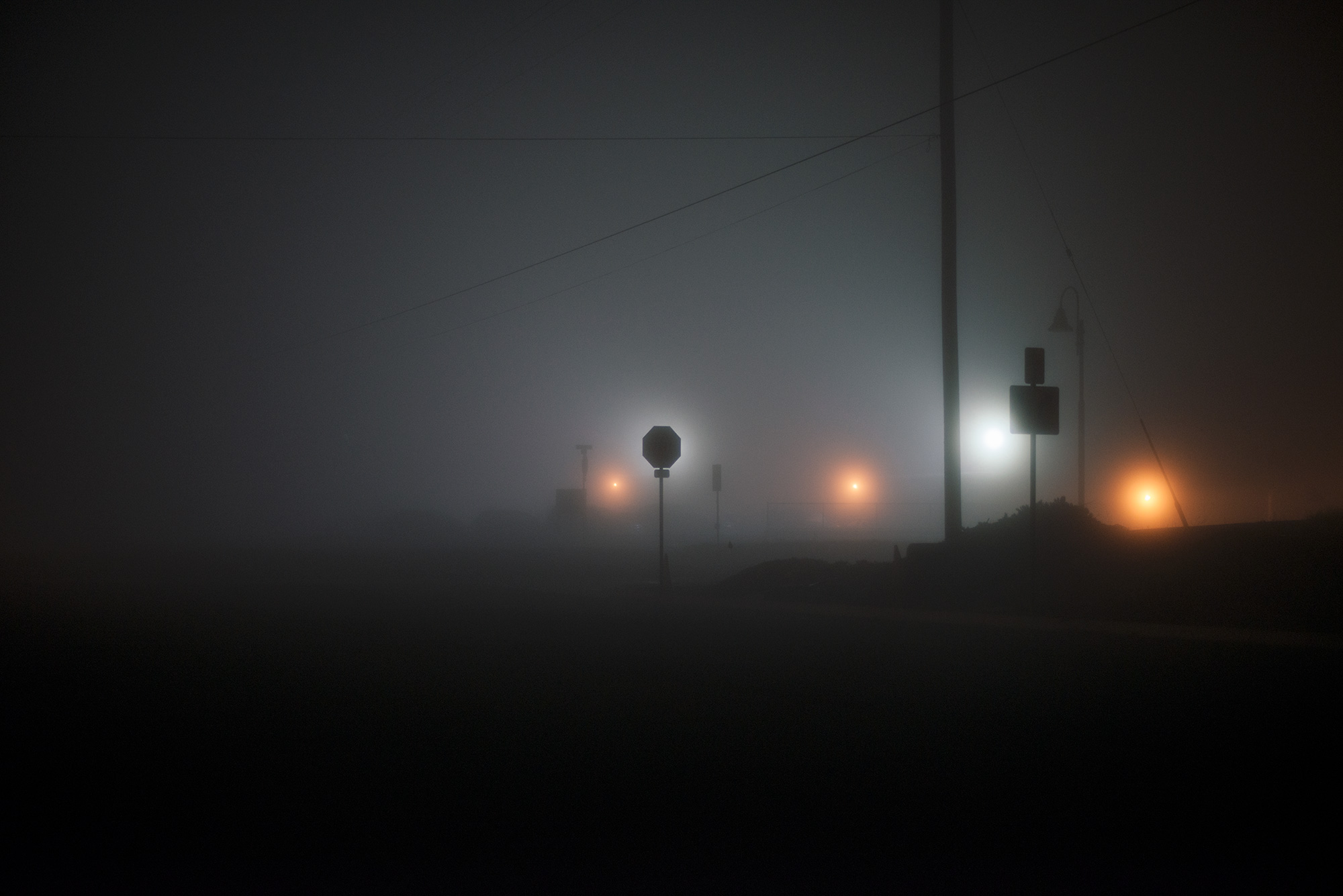 Stop sign at night with fog.